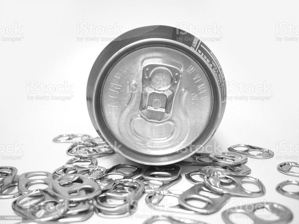 Black & white soda pop in pile of poptabs. royalty-free stock photo