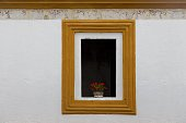 istock Black Window White Wall Red Roses Vase Antigua Guatemala Residential District 1174892721