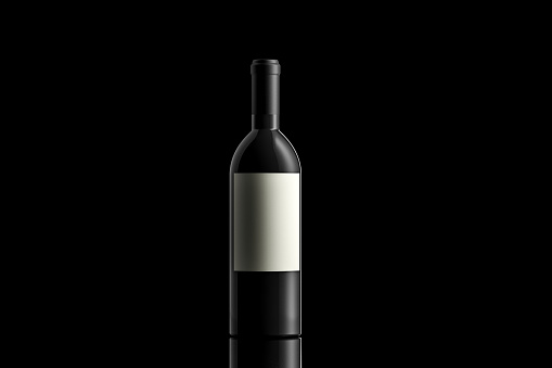 Black wine bottle with an empty label on black background