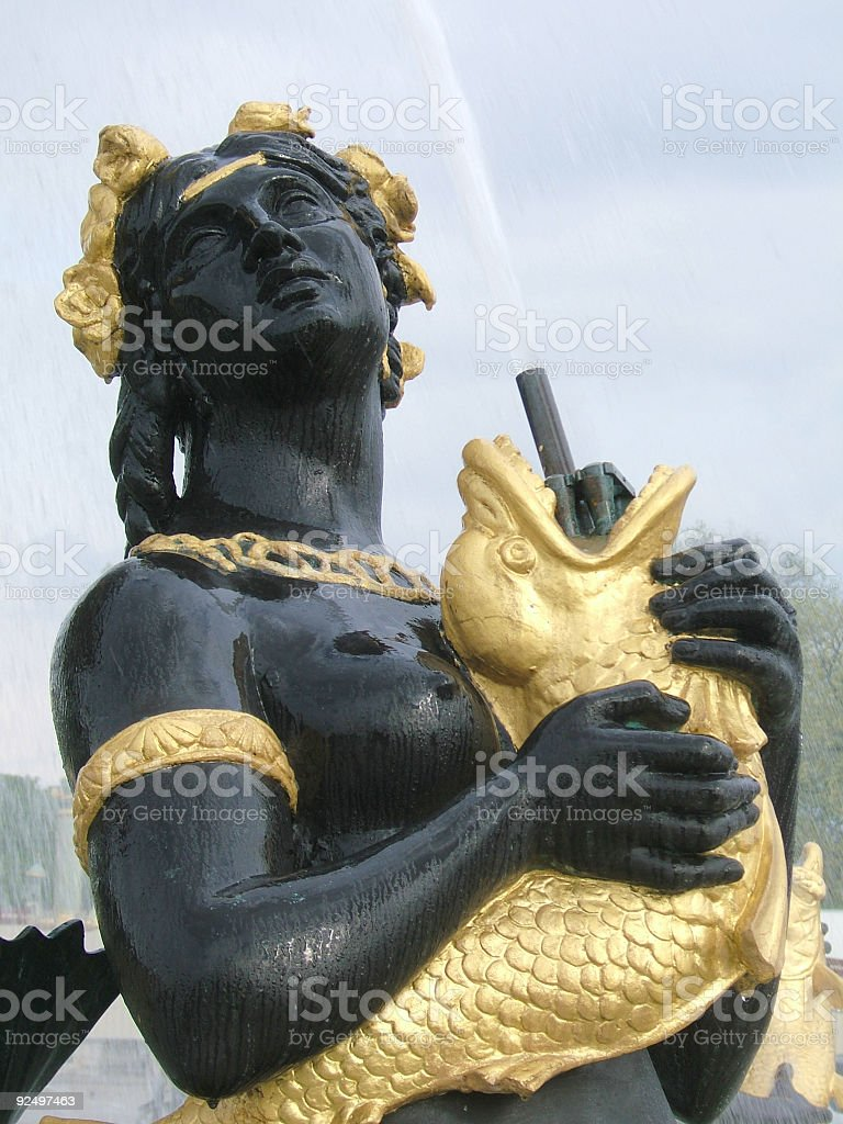 Black woman and gold fish royalty-free stock photo