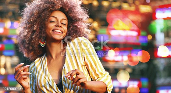 istock Black woman dancing at a concert. 1012989218