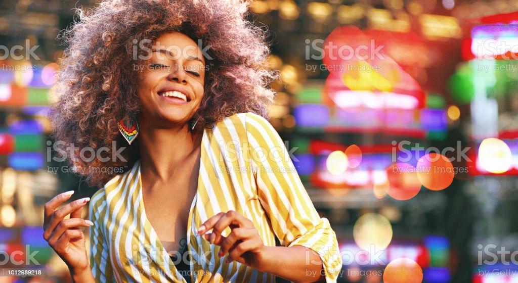 Black woman dancing at a concert. stock photo