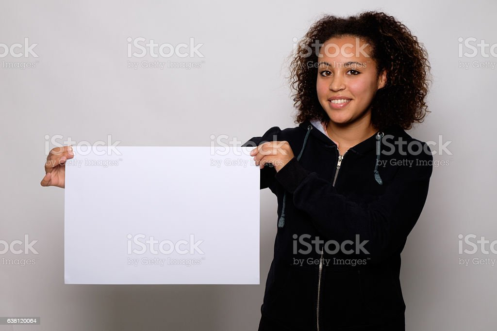 Black woman displaying white banner isolated on background stock photo