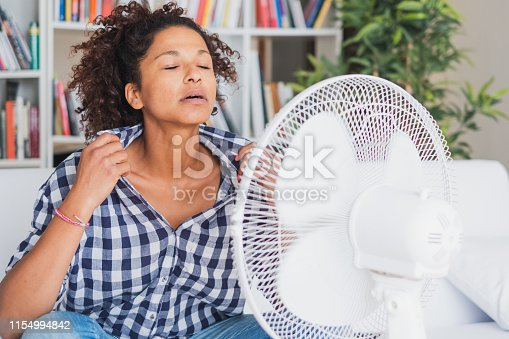 Woman during summer heat looking for refreshment