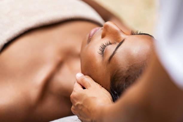 Black woman getting head massage stock photo