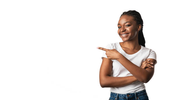 Black Woman In Braces Pointing Finger Aside, White Background, Panorama stock photo
