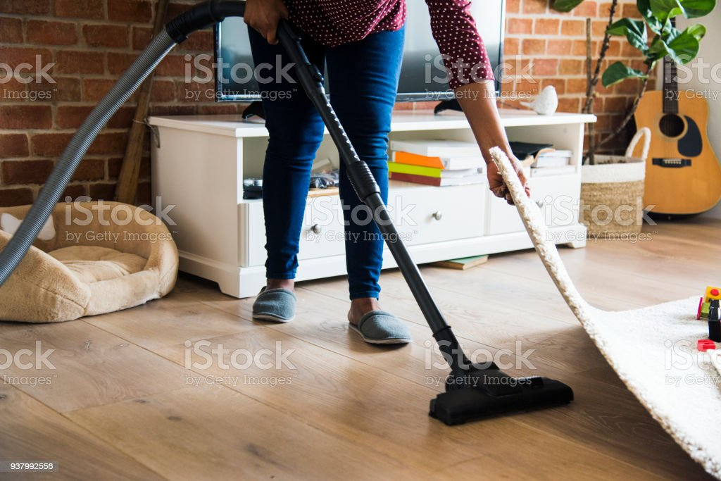 Black woman is cleaning room stock photo