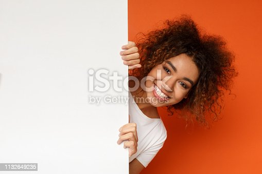 istock Black woman looking out of white blank card 1132649235