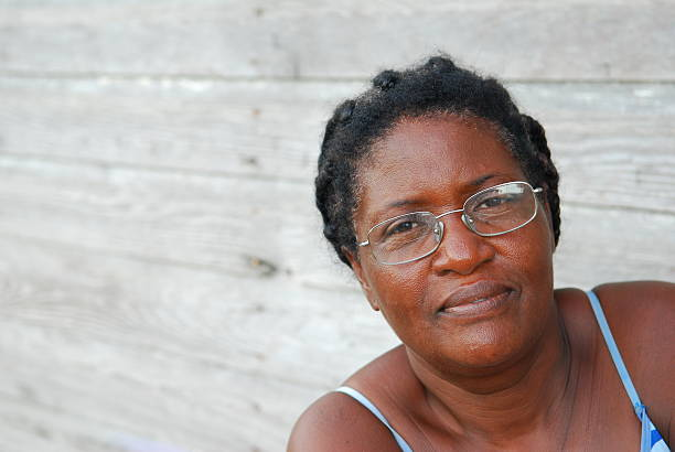 Black Woman in the Caribbean A black woman of Haitian ancestry living on the Caribbean coast of Panama haitian ethnicity stock pictures, royalty-free photos & images