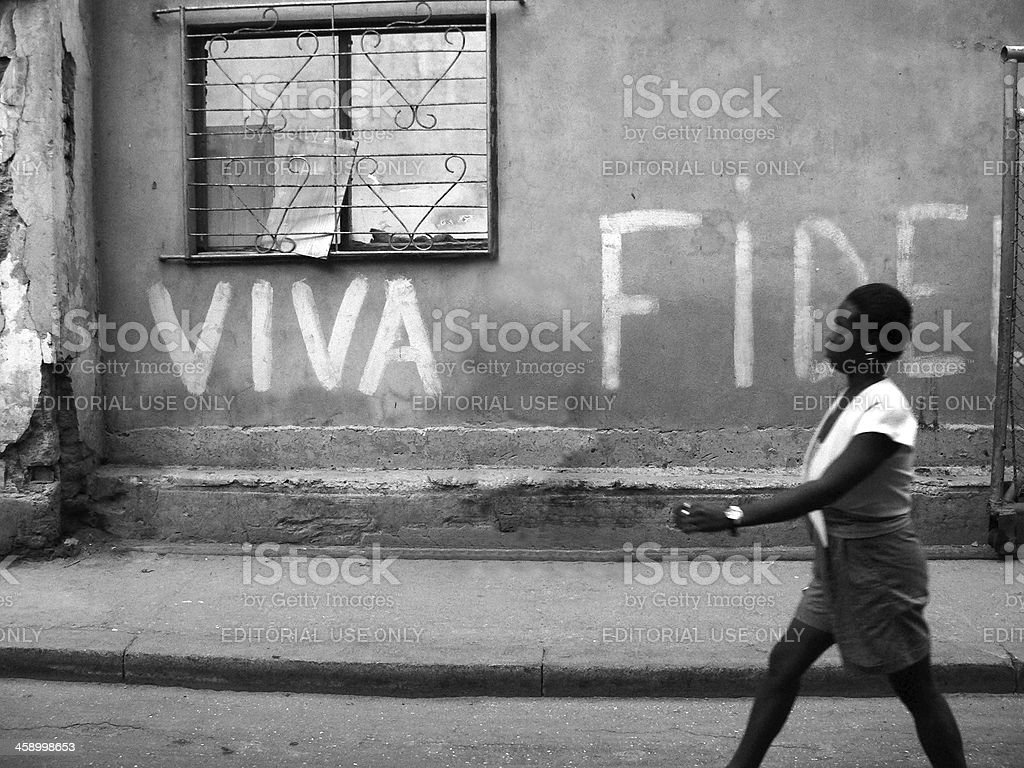 Black woman passing a wall