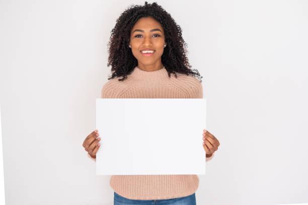 Black woman smile displaying white banner portrait stock photo