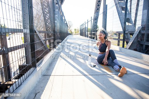 Beautiful black woman working out in the city