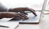 istock Black woman typing on laptop keyboard while working in office 1189336762