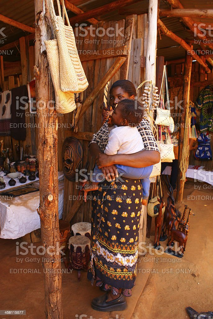 Black woman with child at Craft market in Mbabane, Swaziland stock photo