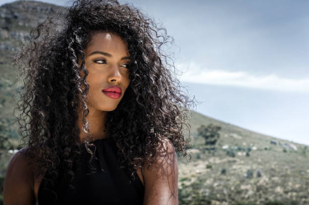 Black woman with red lips looking at camera stock photo