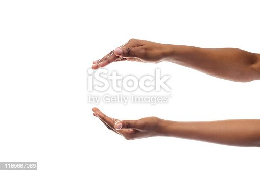 Black Lady's Hands Holding Or Giving Something Invisible Isolated On White Studio Background. Panorama, Empty Space