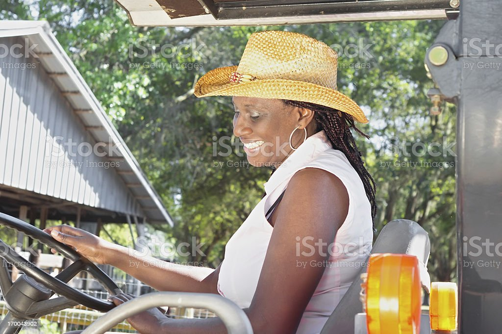 Black women driving a tractor royalty-free stock photo
