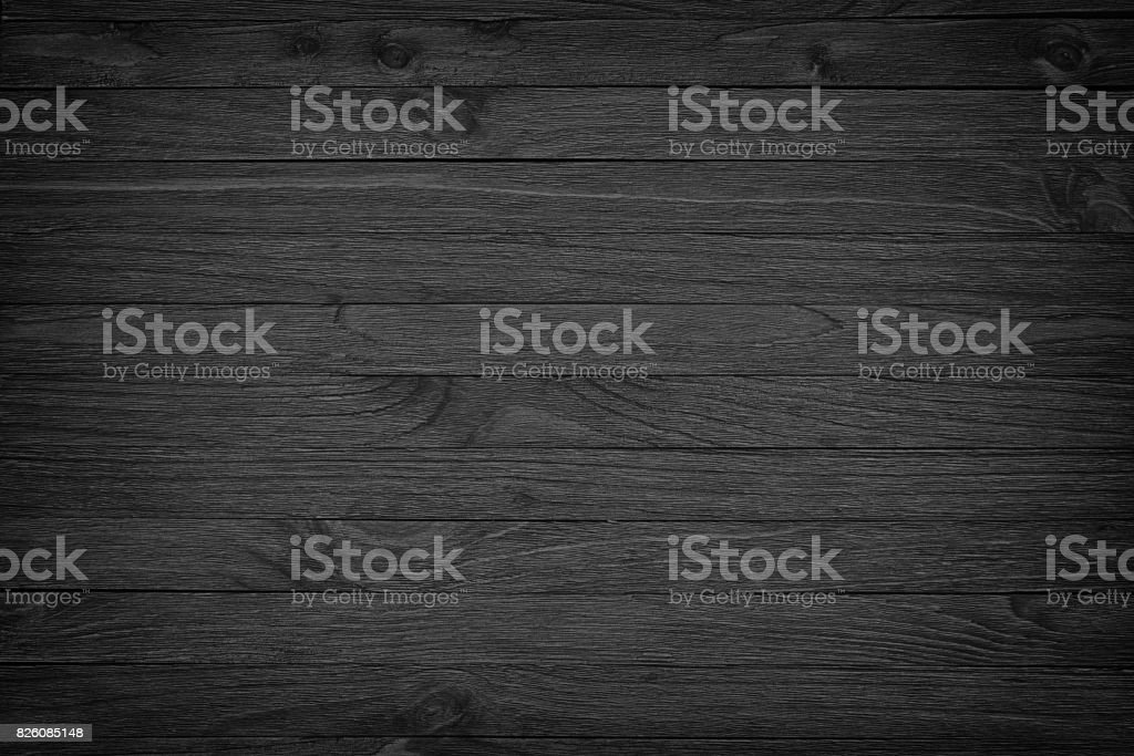 black wooden background or gloomy wood grain texture stock photo