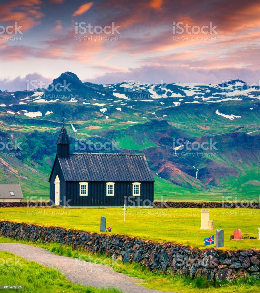 Black wooden Budakirkja church and cemetery at Snaefellsnes. stock photo