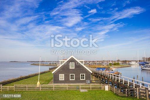 istock Black wooden building in the harbor of Hindeloopen 1322114035