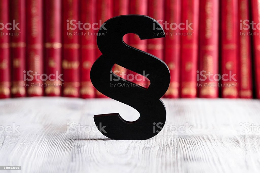 Black wooden paragraph the symbol of law stock photo