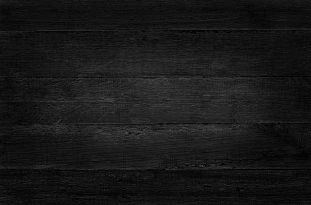 Black wooden wall background, texture of dark bark wood with old natural pattern for design art work, top view of grain timber. - foto stock