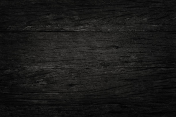 black wooden wall background, texture of dark bark wood with old natural pattern for design art work, top view of grain timber. - dark wood texture stock photos and pictures