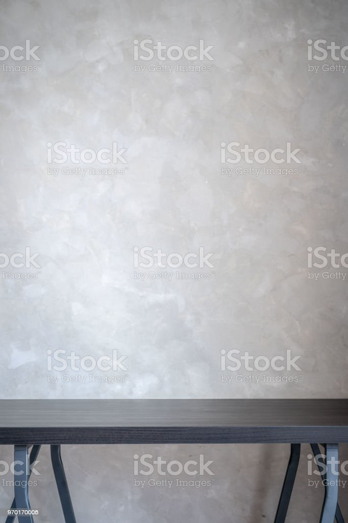 Black wooden work table against concrete loft wall background included copyspace for add text or graphic stock photo