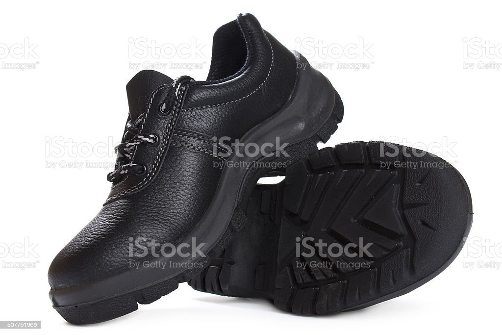Black work boots  on white background stock photo