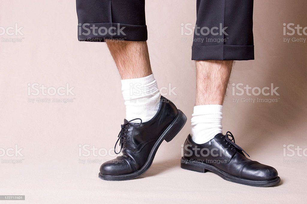 Black work shoes with white socks and ankles stock photo