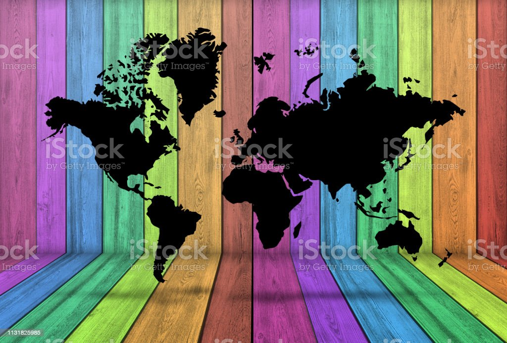 A black World map in a room with wood wall and floor colored with...
