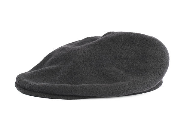Black woven beret flat-crowned hat isolated stock photo