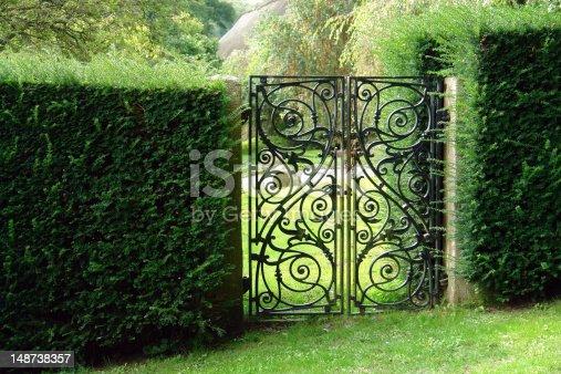 istock Black wrought iron garden gate 148738357