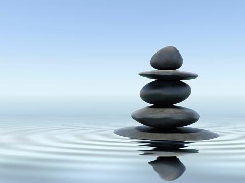 Black zen stones in shallow water