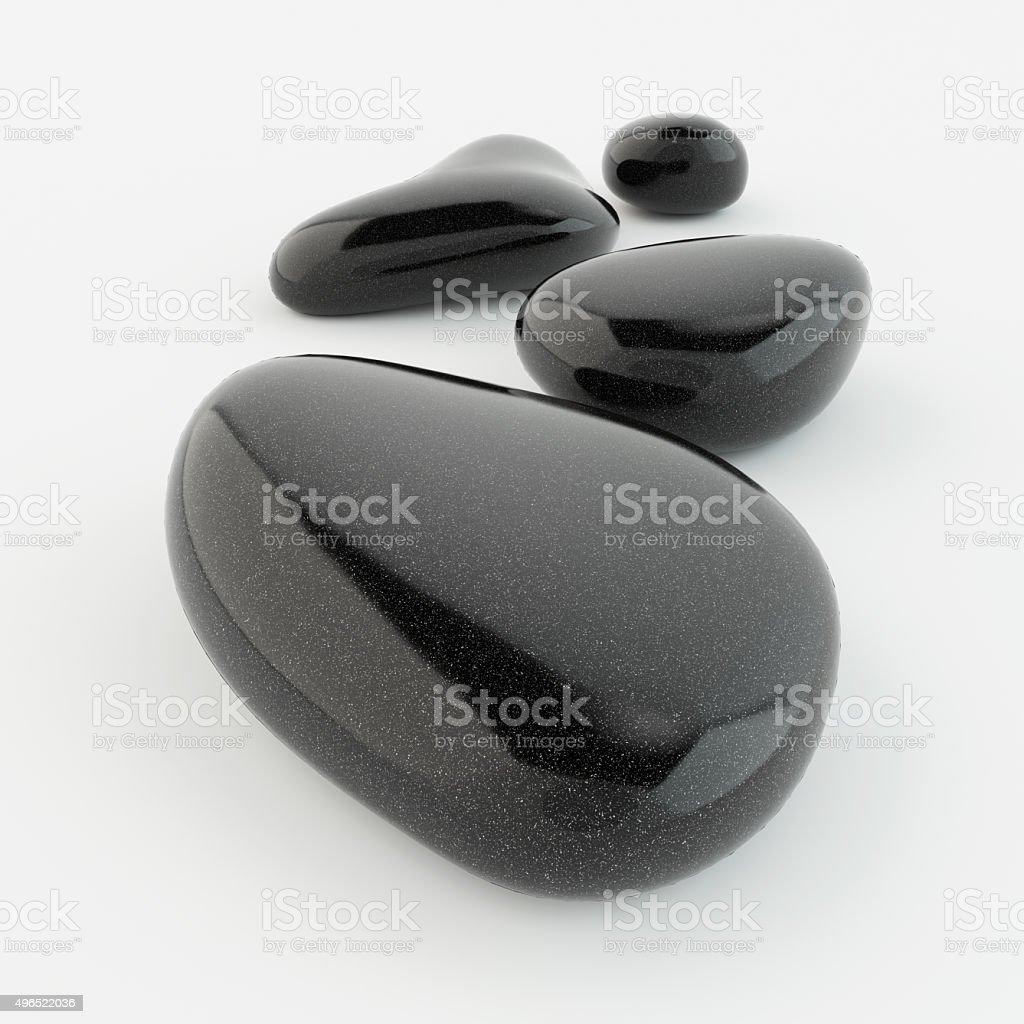 Black zen stones on white background. stock photo