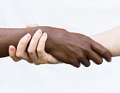 istock Black-and-white human arms wrapped around each other. The concept of combating racism, friendship, equality 1251951588