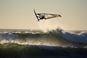 windsurfer jumping in waves