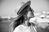 istock Black-and-white portrait of a woman at the marina 1296735669