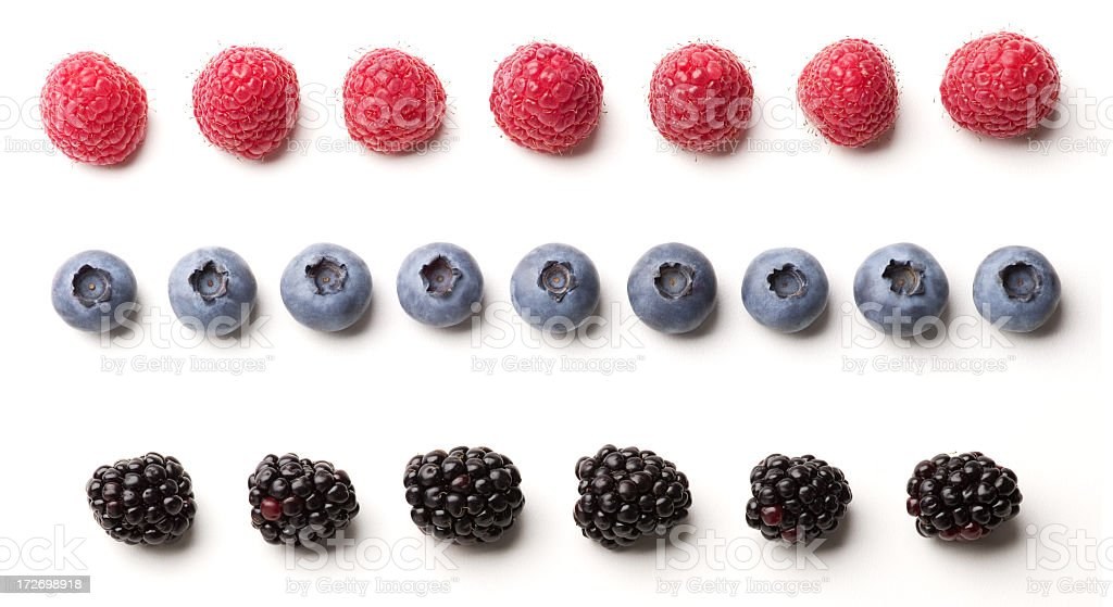 Blackberries, blueberries and raspberries laid out in rows stock photo
