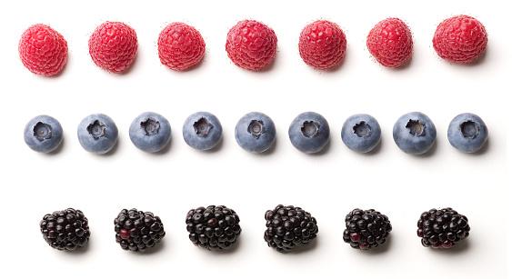 Blackberries Blueberries And Raspberries Laid Out In Rows ...