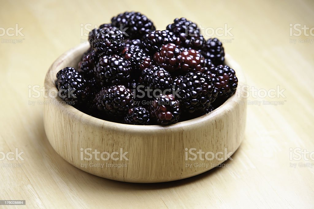 Blackberries in a bamboo bowl royalty-free stock photo
