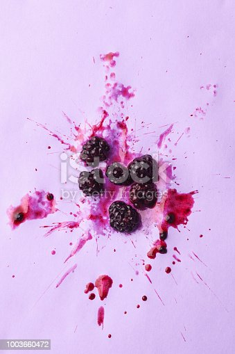 blackberries splash  on purple background