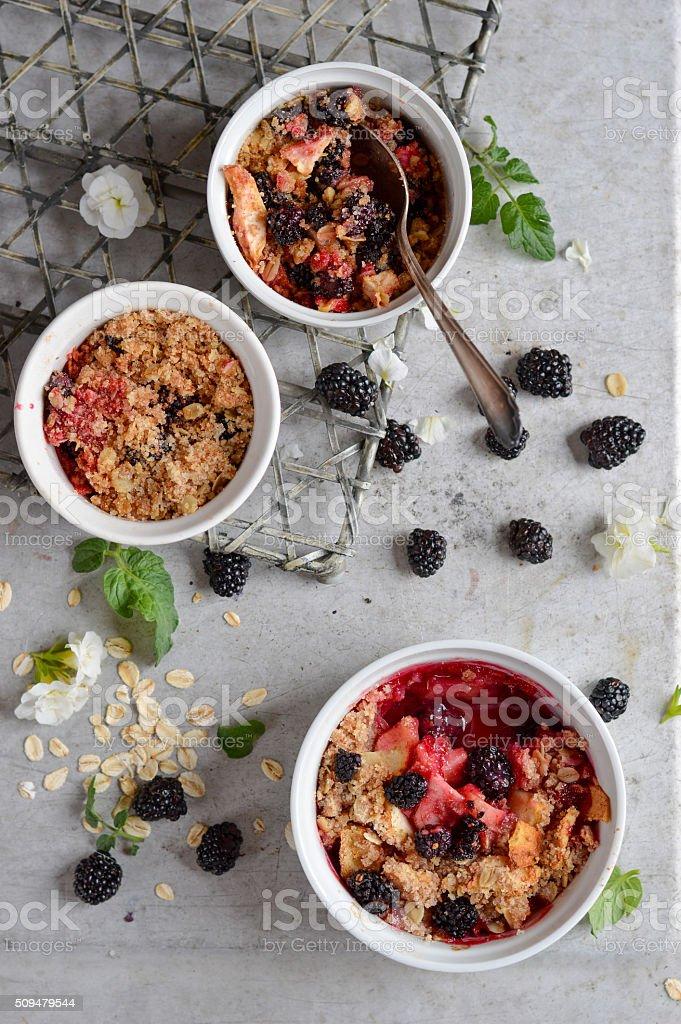 Blackberry and apple crumble dessert stock photo