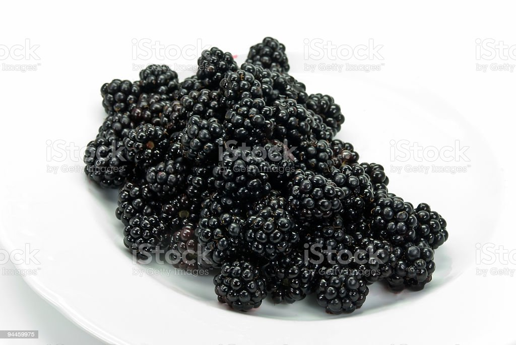 Blackberry in the plate , isolated on white royalty-free stock photo