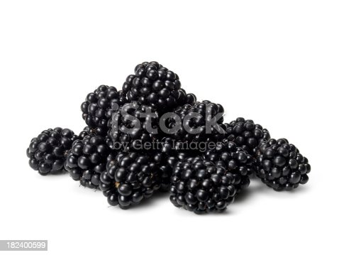 close up of blackberries on white