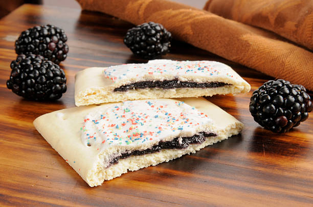 Blackberry toaster pastries Blackberry filled toaster pastries with frosting pastry dough stock pictures, royalty-free photos & images