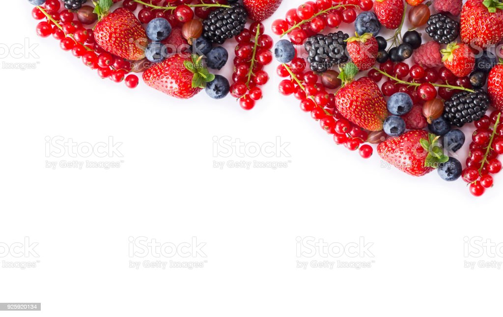 Black-blue and red food on a white. Ripe currants, strawberries, blackberries, bluberries and raspberries on a white background. Mixed berries with copy space for text. Black-blue and red berries and fruits. Various fresh summer berries on white backgroun stock photo
