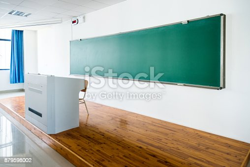 istock Blackboard and lectern in lecture hall 879598002