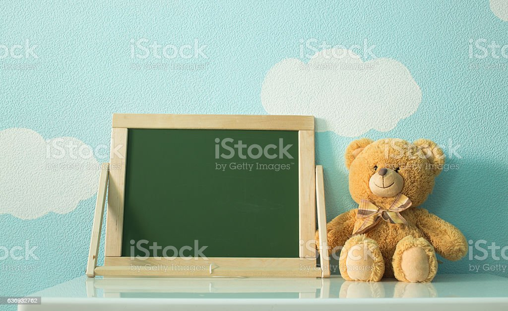 blackboard and toy on a background of clouds and sky stock photo