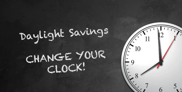 Blackboard Clock Message - Daylight Savings Blackboard & Clock Message saying Daylight Savings, Change Your Clocks daylight savings stock pictures, royalty-free photos & images